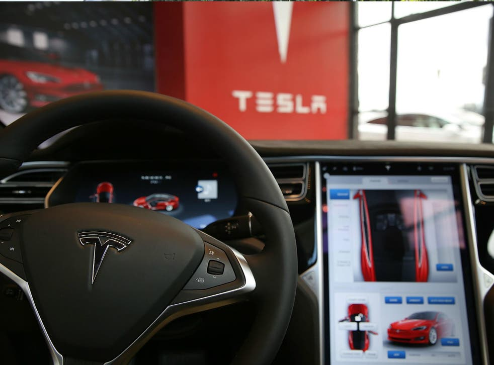 The inside of a Tesla vehicle is viewed as it sits parked in a new Tesla showroom and service center in New York City