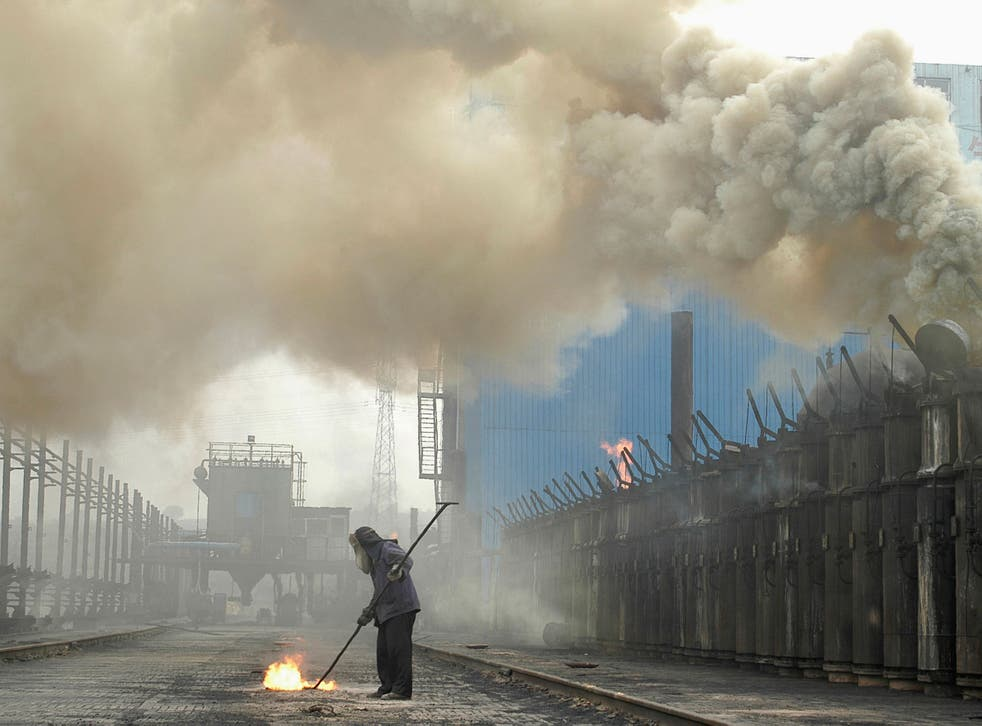 A labourer works at a coking plant in Changzhi, Shanxi province, China