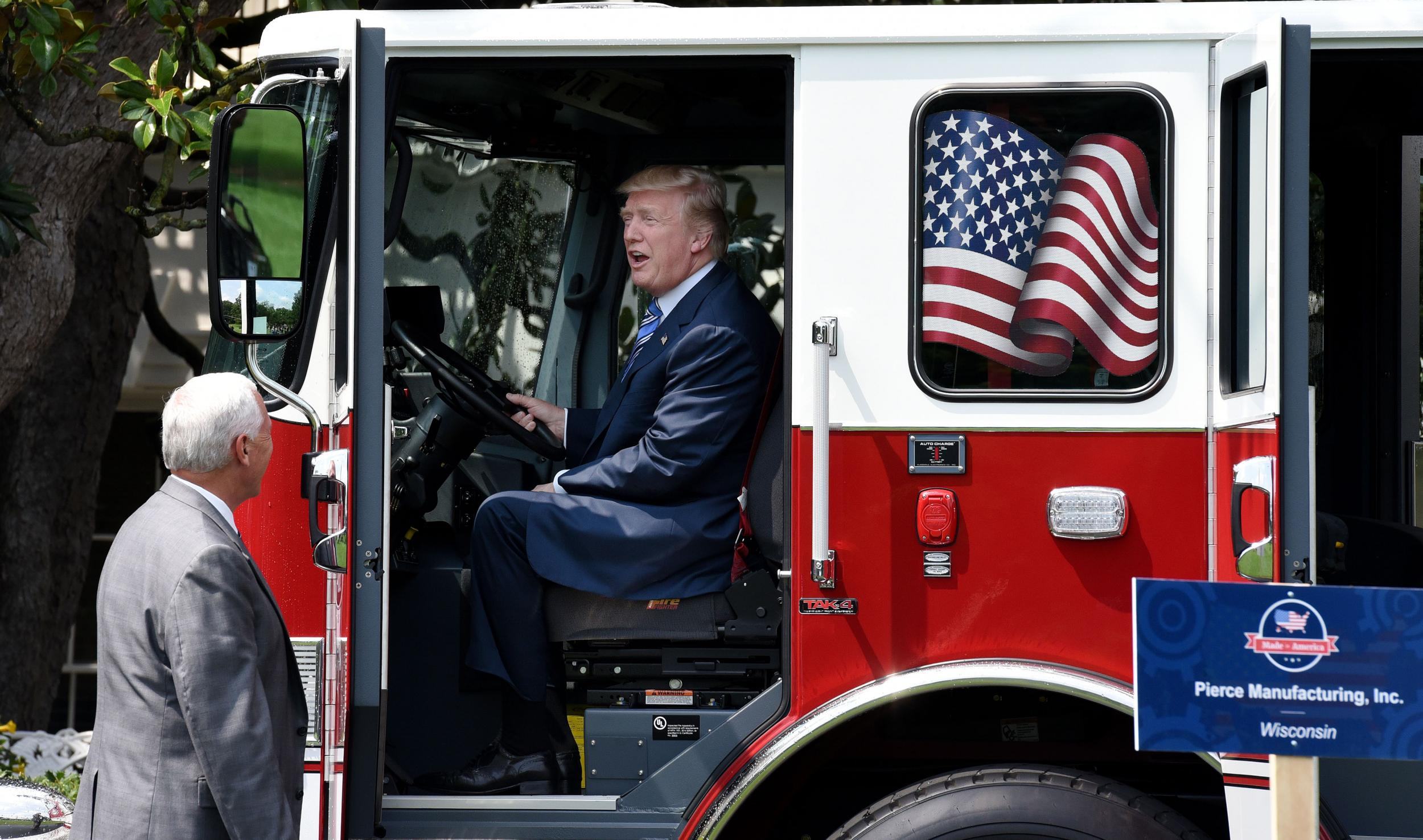 As trump s healthcare bill was on the brink of collapse he played with a fire truck and baseball bat the independent