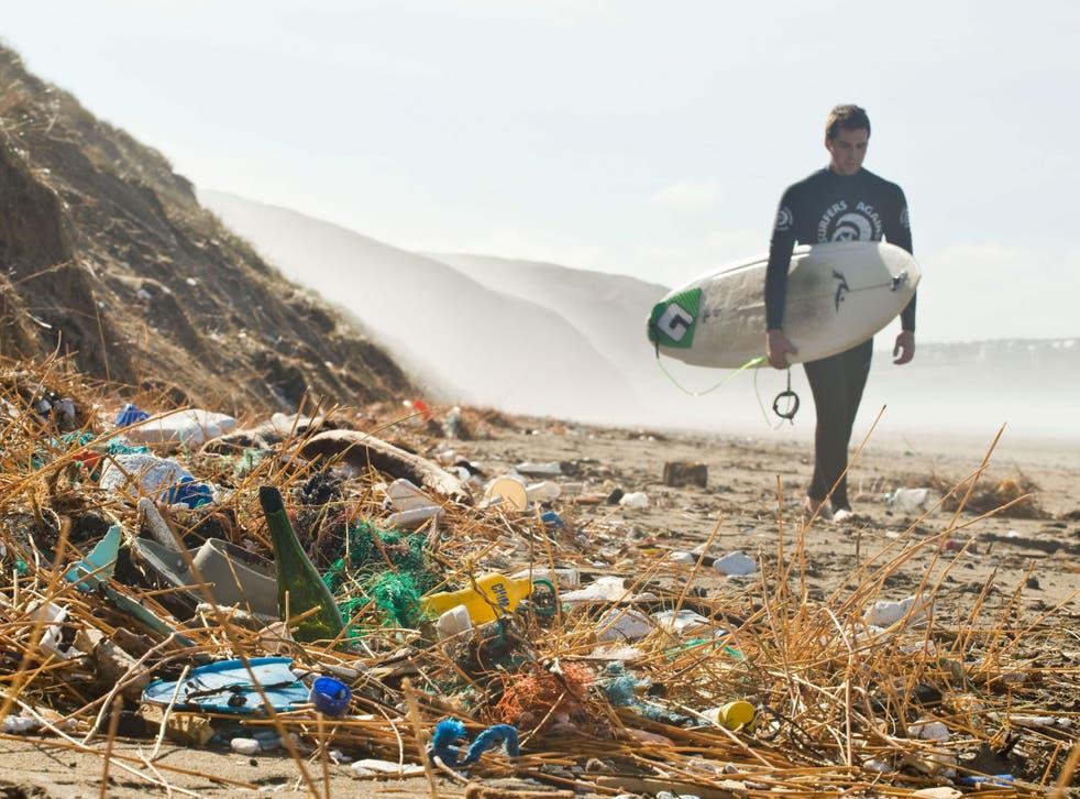 Plastic rubbish strewn along Perranporth beach in Cornwall