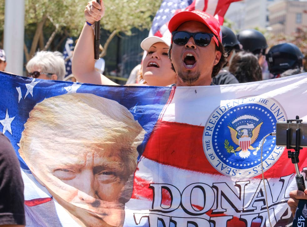 Donald Trump supporters demonstrating against anti-Trump protesters calling for the president's impeachment in Los Angeles