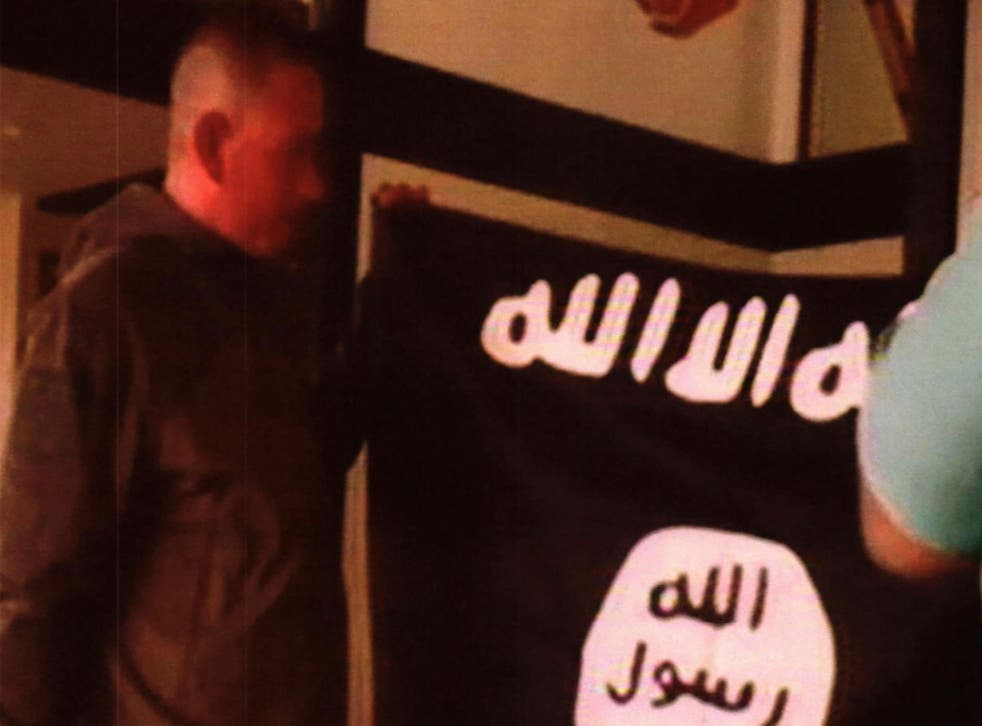 Ikaika Erik Kang is accused of holding an Isis flag while pledging allegiance to the militant group