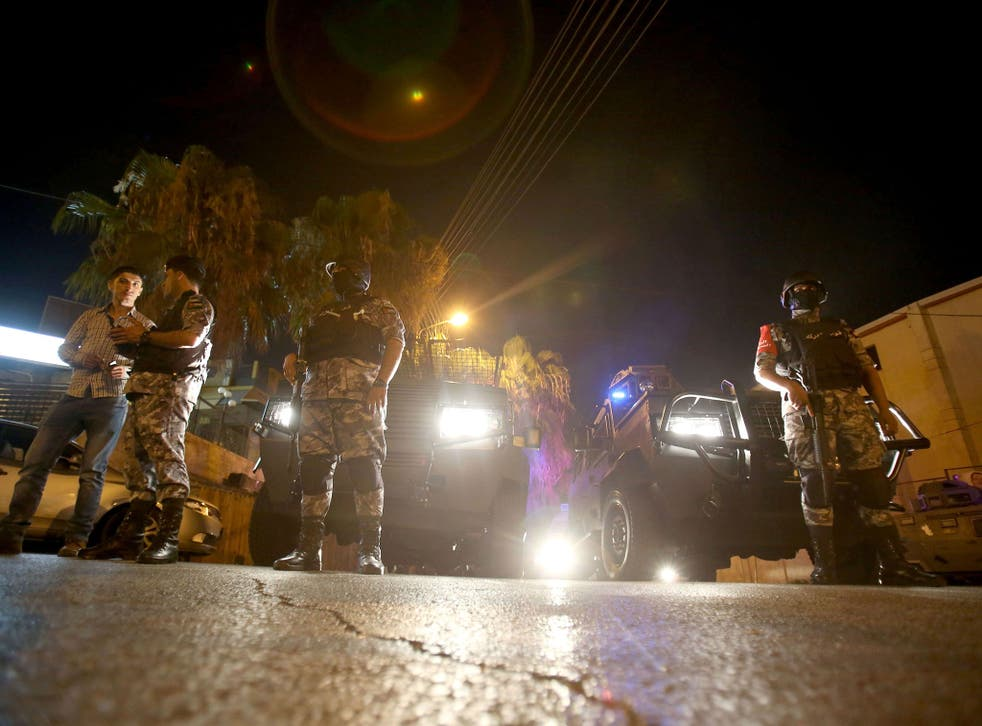 Security forces stand guard outside the Israeli embassy in the Rabiyeh neighbourhood of the Jordanian capital Amman following a security incident on 23 July 2017.