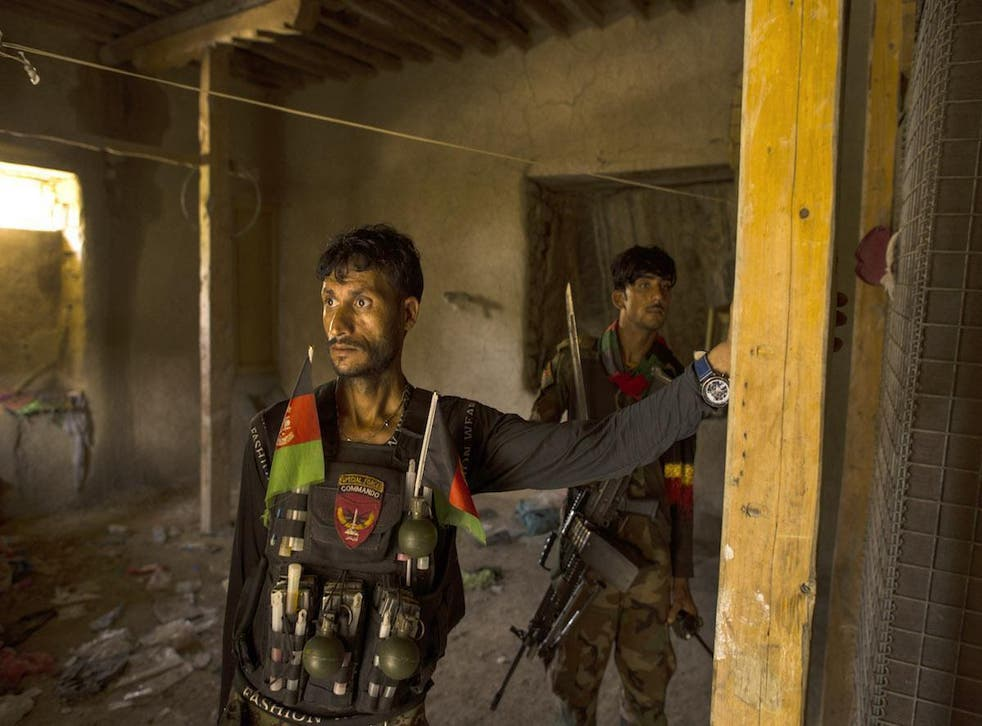 Afghan commandos man a checkpoint in Afghanistan's Momand Valley. The building was captured from the Islamic State in Khorasan, which used it as a prison and court