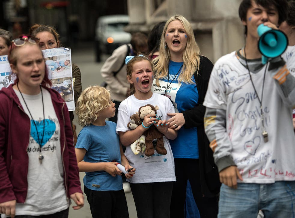 Campaigners outside the High Court where the terminally ill baby's gave an emotional statement after ending their legal fight for an experimental treatment
