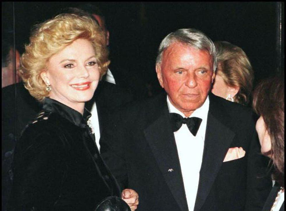 A 1996 file photo showing Frank Sinatra and his wife Barbara arriving at the Carousel of Hope benefit in Beverly Hills, California
