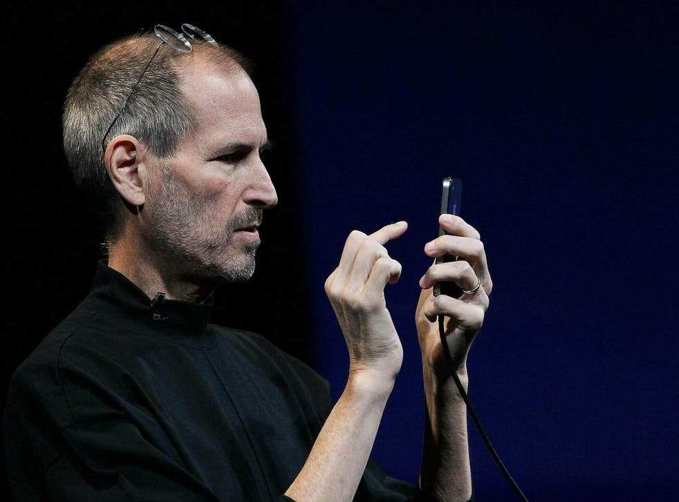 Apple CEO Steve Jobs demonstrates the new iPhone 4 as he delivers the opening keynote address at the 2010 Apple World Wide Developers conference June 7, 2010 in San Francisco, California