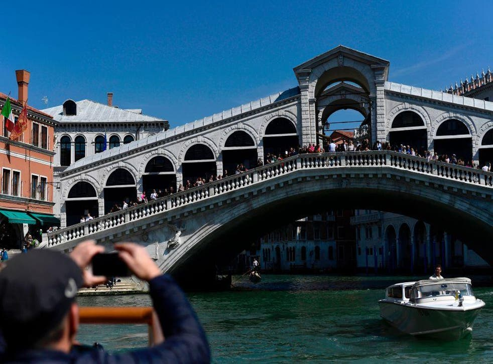 Tourists treat Venice as if it's a beach, authorities say