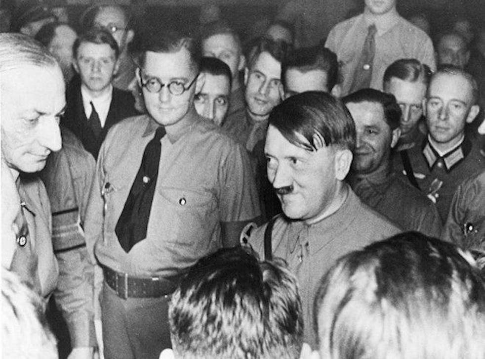 Adolf Hitler being greeted by 'old companions' at his arrival at the Buergerbraeukeller.