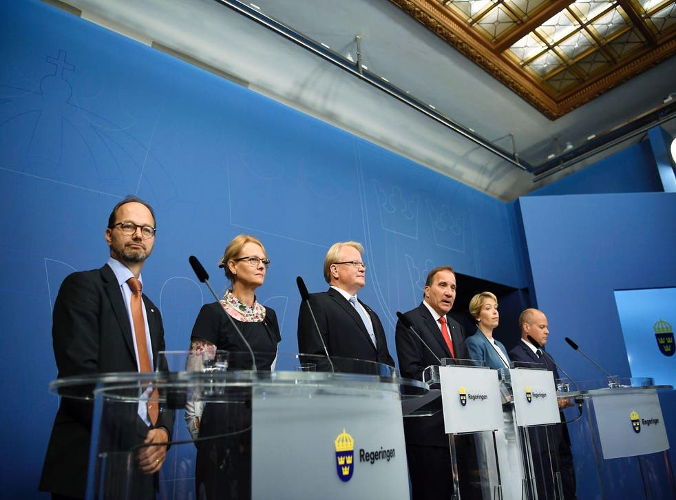 (L-R) Sweden's Minister for Infrastructure Tomas Eneroth, Minister for Migration, Helene Fritzon, Minister of Defence Peter Hultqvist, Prime minister Stefan Lofven, Minister for Social Security Annika Strandhall and Minister for Home Affairs and Justice Morgan Johansson attend a press conference at Rosenbad, the Swedish government headquarters, in Stockholm on July 27, 2017