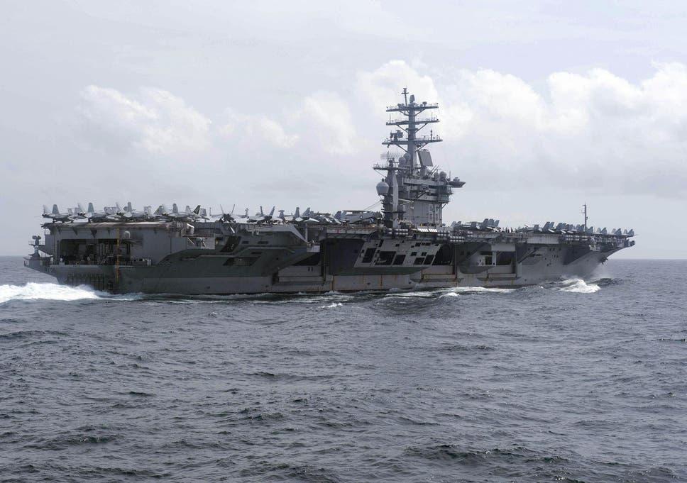 US Navy fires warning shot near Iranian vessels, Iranian