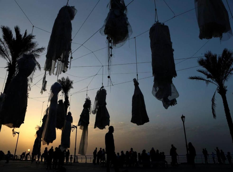 Wedding dresses were strung up along Beirut's Corniche in April in a protest targeting a similar article in the Lebanese penal code (Abaad)