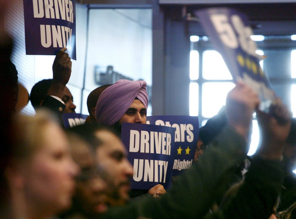 Backers of a Seattle ordinance allowing ride-for-hire drivers to unionize cheer as the City Council votes in favor on Dec. 15, 2015