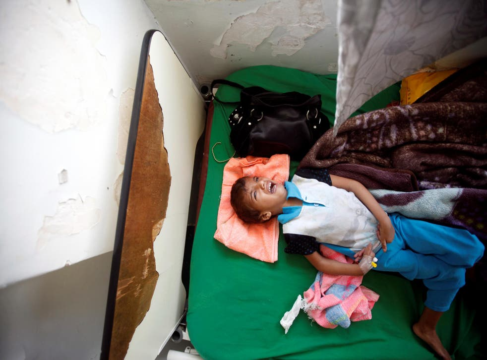 A boy cries as he lies on a bed of a hospital in Sanaa, Yemen on 27 July, 2017. Less than half of the country's medical facilities are functional in the face of a huge cholera epidemic