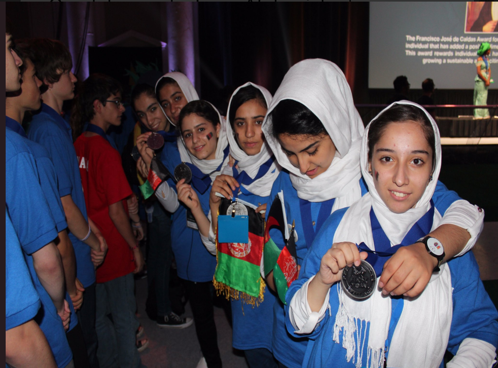 Fatemah Qaderyan (far right) led a team of her classmates to a second place finish in the First Global Challenge international robotics contest in Washington DC