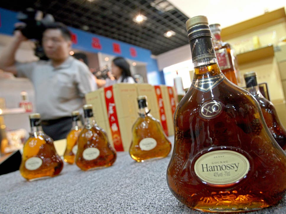 Cracking down on chinas dangerous fake food sector the independent visitors walk past counterfeit liquor on display at the beijing administration for industry and commerce center fandeluxe Image collections