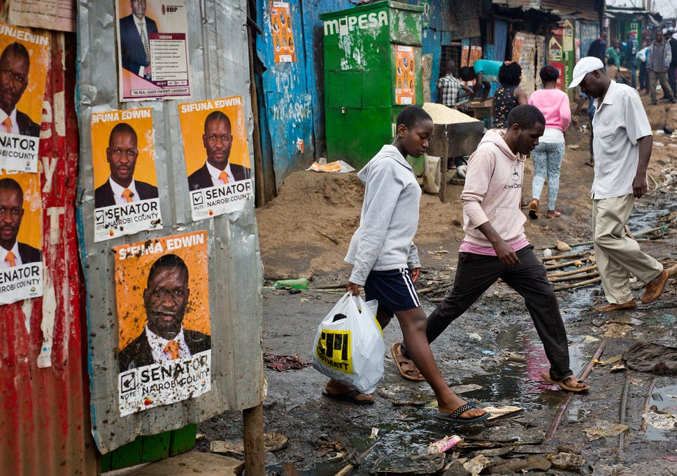 Kenya election 2017 this time round theres not one flashpoint for kenyans walk past election posters in nairobis kibera slum rising living costs and inadequate healthcare fandeluxe Choice Image