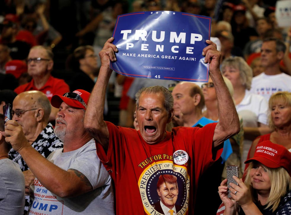 Donald Trump supporters listening to the President speak at a rally in Huntington, West Virginia, on 3 August 2017