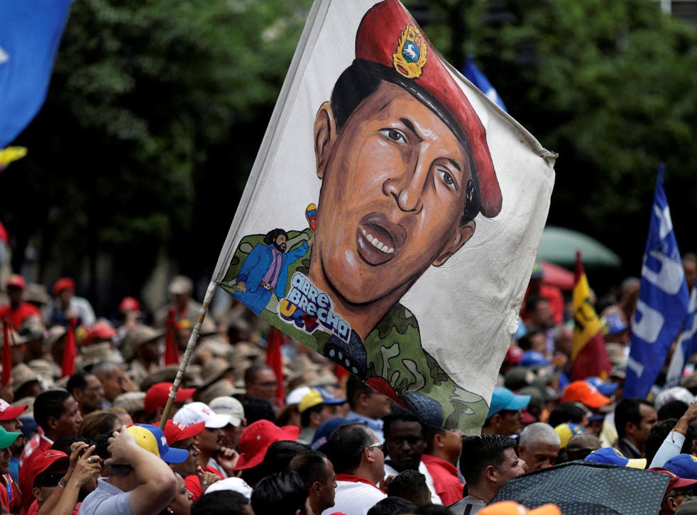 Pro-government supporters with an image of late President Hugo Chavez at a march in Caracas