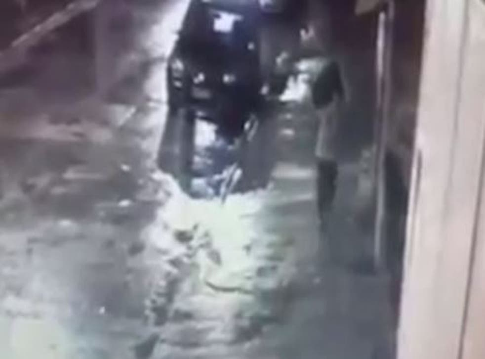 CCTV footage showed a man throwing a suitcase into a river, which is believed to have contained the six-year-old