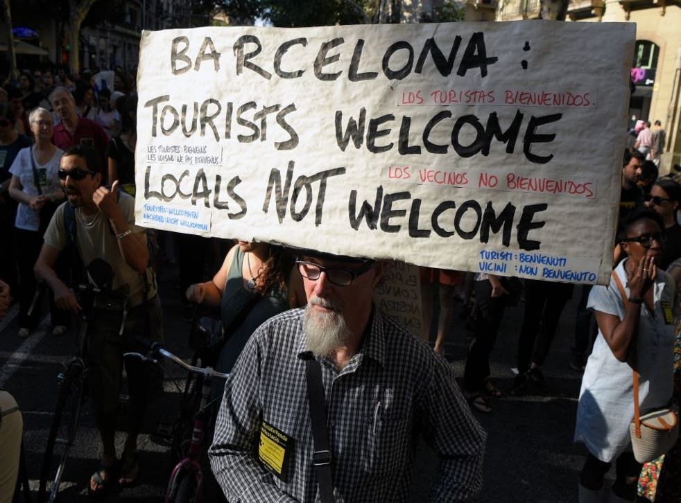 Protesters demonstrating against tourism in Barcelona in June
