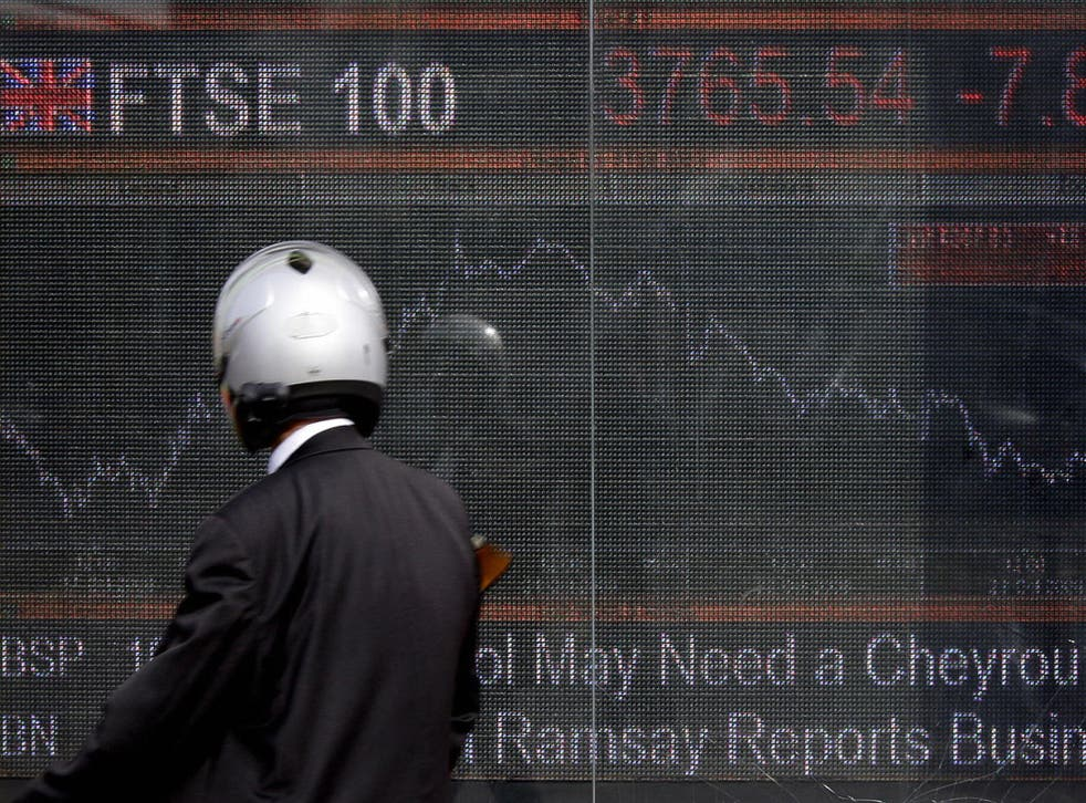 An electronic display board showing the FTSE 100 share index in London on 24 October 2008