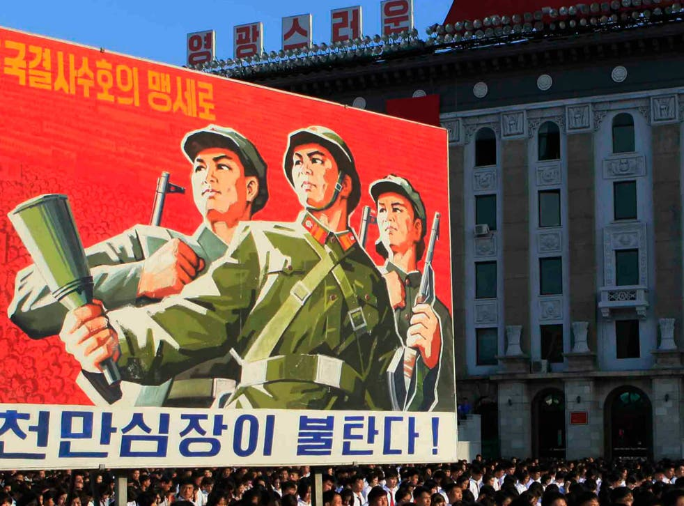 North Koreans rally in Pyongyang on August 9, 2017 as tensions escalate between their country and Donald Trump