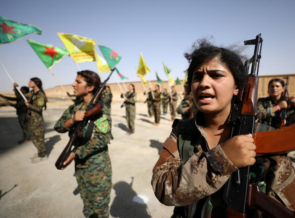 Syrian Democratic Forces female fighters hold their weapons during a graduation ceremony in the city of Hasaka, northeastern Syria on 9 August 2017