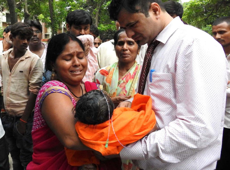 Relatives mourn the death of a child at the Baba Raghav Das Hospital in Gorakhpur