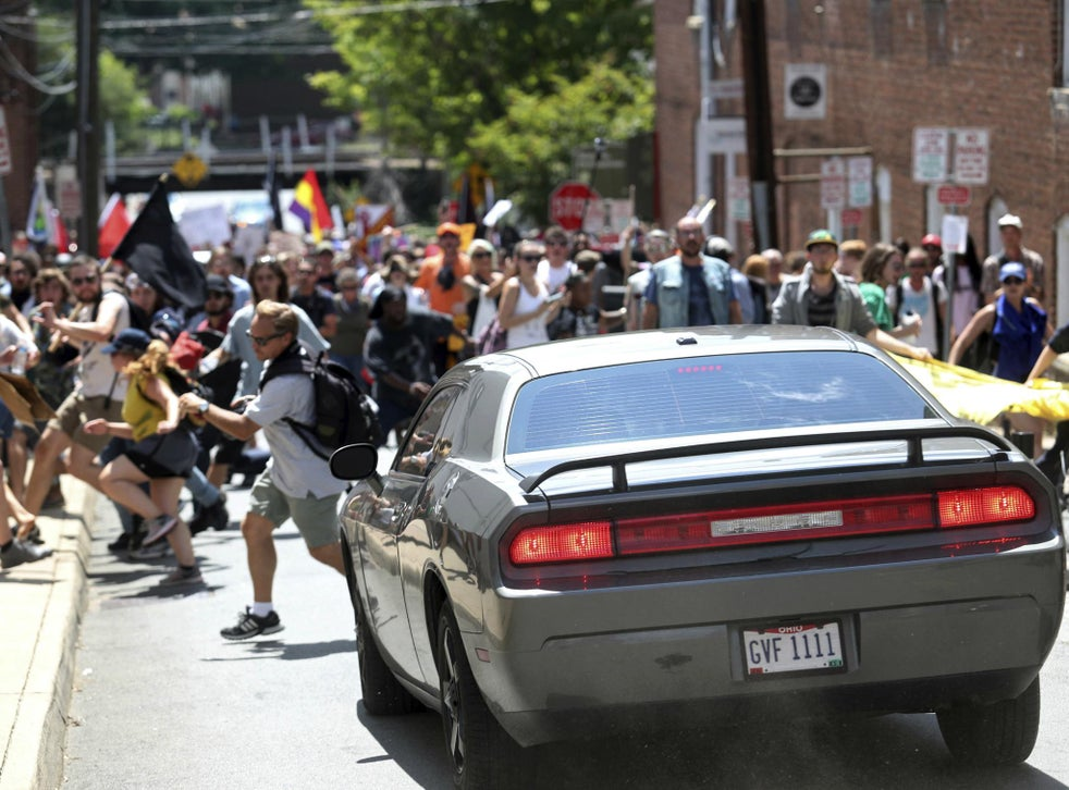 A car drives into protesters in Charlottesville Virginia One person was killed and more were injured