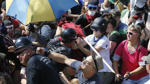 White nationalist demonstrators clash with counter demonstrators at the entrance to Lee Park in Charlottesville, Virginia. A state of emergency is declared, August 12 2017