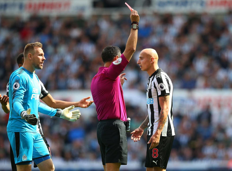 Jonjo Shelvey is shown a red card for stamping on Dele Alli
