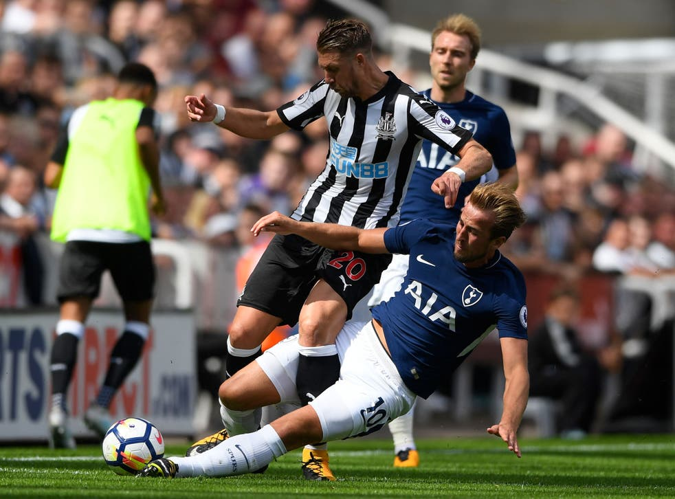 Harry Kane was shown a yellow card for his rash challenge on Newcastle debutant Florian Lejeune