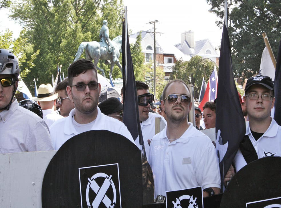 James Fields, second from left, was pictured holding a black shield in Charlottesville hours before he drove a car into a group of anti-fascist protesters
