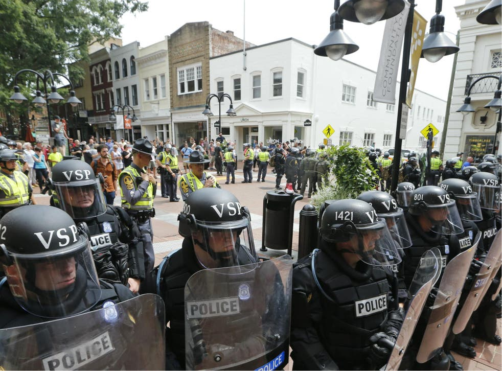 Virginia State Police cordon off an area around the site of several clashes between white supremacists and counter-protesters which resulted in the death a protester, two state police officers, and several injuries