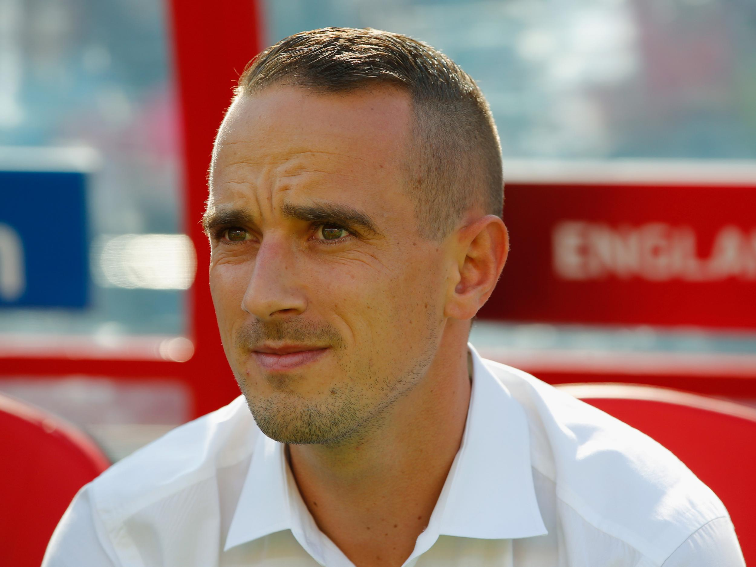 Mark Sampson: England women's football coach cleared of making 'racial and prejudicial' remark to a player