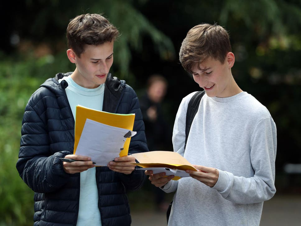 Twin Students James (left) and Toby Houston collect their A-level results at Peter Symonds college in Winchester, Hampshire