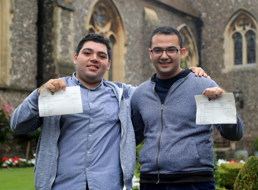 Syrian refugees Sulaiman Wihba, left, and Elias Badin after collecting their A-level results at Brighton College