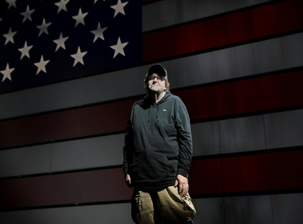Michael Moore poses for a portrait at the site of his one-man Broadway show at the Belasco Theatre in Manhattan
