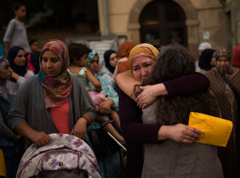Members of the local Muslim community gather along with relatives of young men believed responsible for the attacks in Barcelona and Cambrils to denounce terrorism and show their grief in Ripoll, north of Barcelona, Spain