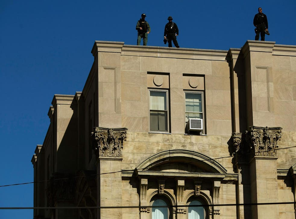Police officers stand on top of the Jefferson County courthouse in Steubenville, Ohio in this photo from 2008