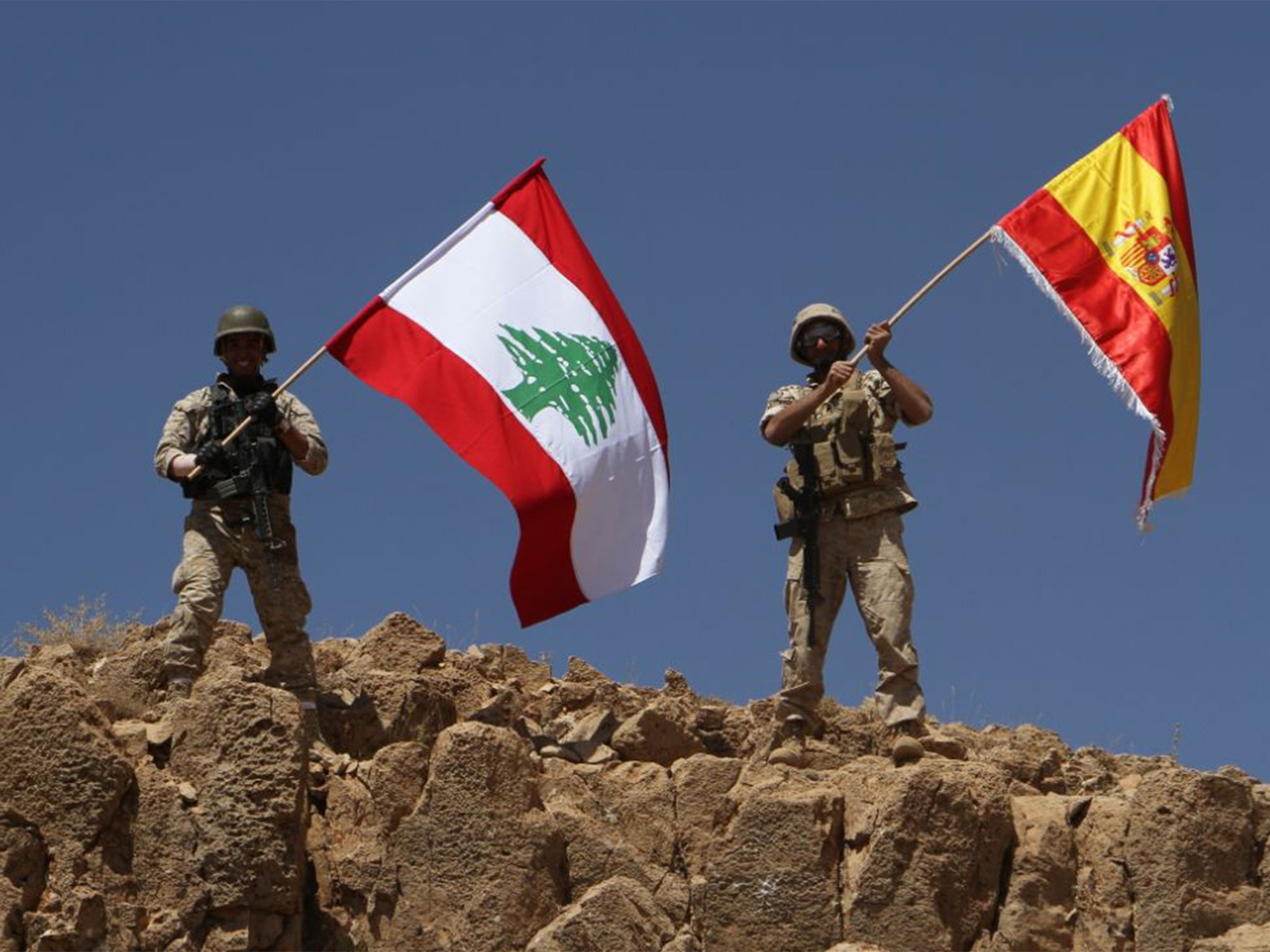 lebanese army recaptures land from isis and raises spanish flag in
