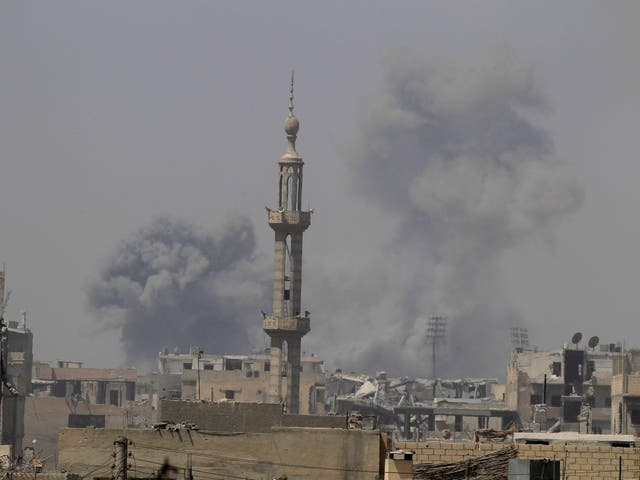 Smoke rises after an air strike during fighting between members of the Syrian Democratic Forces and Islamic State militants in Raqqa, Syria
