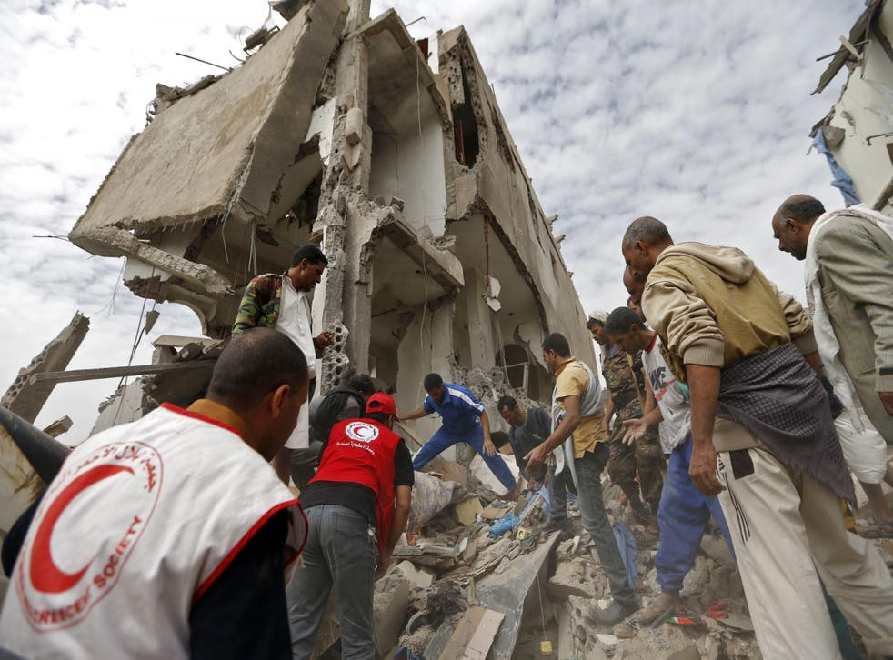 Rescuers search under the rubble of a house destroyed in an air strike in the residential Faj Attan district of the the Yemeni capital Sanaa on 26 August 2017