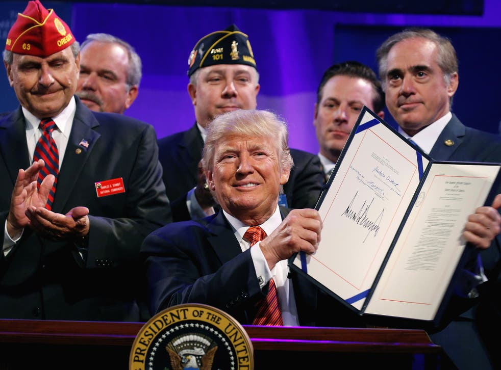 The US President with veterans after singing a bill in Reno, Nevada