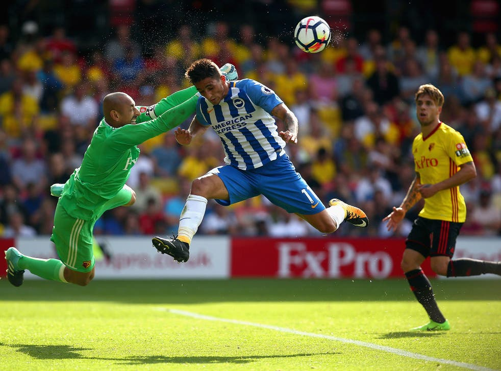 Heurelho Gomes punches the ball away under pressure from Anthony Knockaert