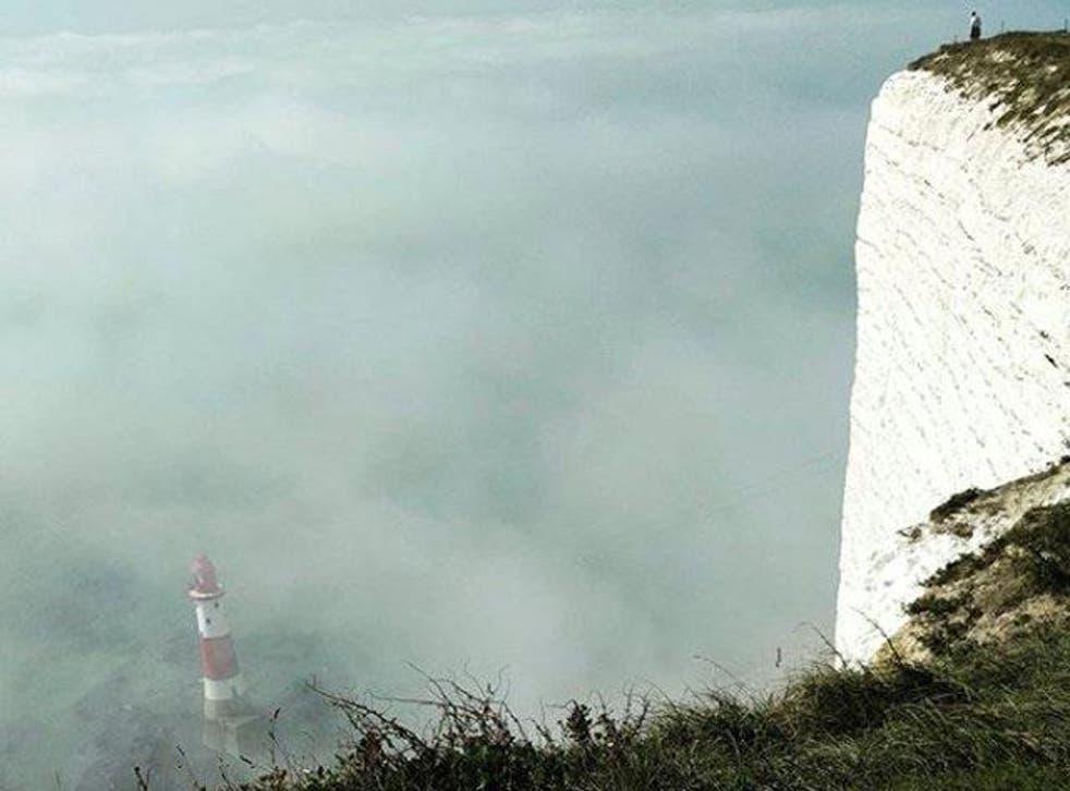 The mist surrounds Beachy Head Lighhouse near Eastbourne on 27 August 2017