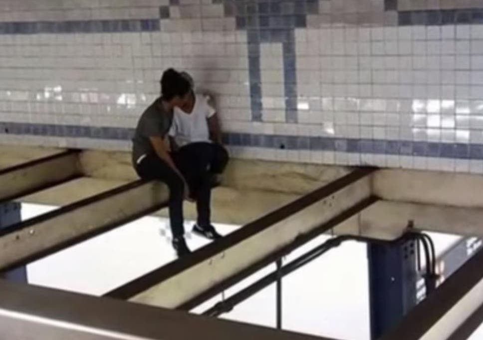 91eea723c82 Man follows suicidal woman onto beam above train platform to talk her down