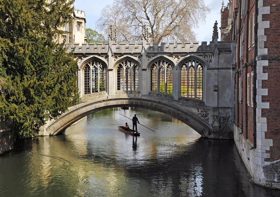 A Punt Passes Beneath The Bridge Of Sighs At St Johns College