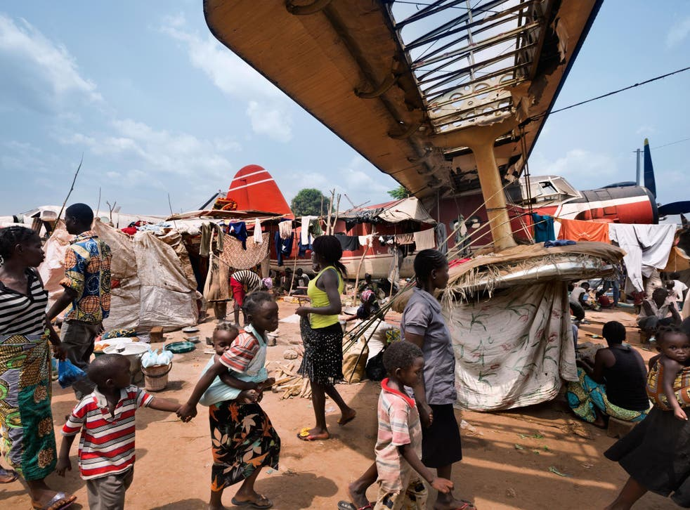 The grounded plane is barely noticeable in this shot from Bangui in the Central African Republic